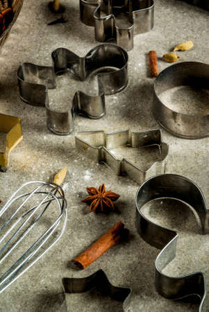 Baking equipment and ingredients, cooking christmas pastries and cookies background, vintage, gray stone table, copy space
