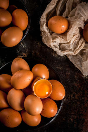 Organic farm chicken eggs, on a plate, on a dark rusty metal background, copy space top view