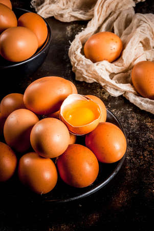 Organic farm chicken eggs, on a plate, on a dark rusty metal background, copy space Stock Photo
