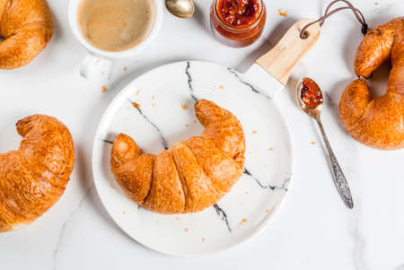 Homemade continental breakfast, croissants, coffee. jam on white marble table, copy space top view Archivio Fotografico