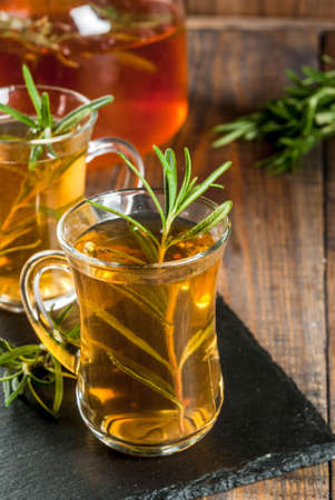 Rosemary tea on  wooden background. Copy space Stock Photo