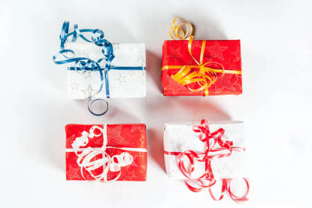 Christmas gift boxes and decorations on white background, top view copy space isolation