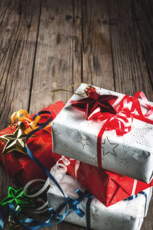 Christmas gift boxes, old rustic wooden background, copy space