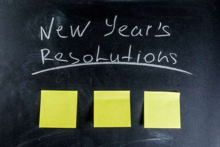 New years resolutions, blackboard background with chalk and blank notes, copy space Stockfoto