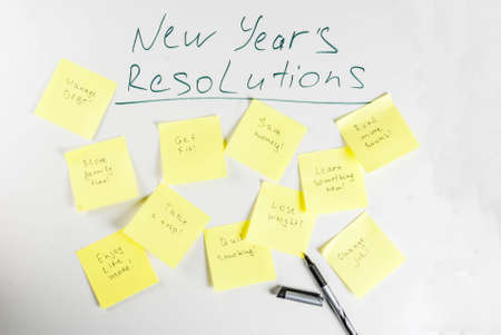 New years resolutions, white board background with colorful sticky notes with popular new year resolutions and pen, copy space Stok Fotoğraf - 90798953