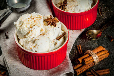 Cold Homemade Eggnog Ice Cream with Cinnamon and anise, on dark stone background, copy space 스톡 콘텐츠
