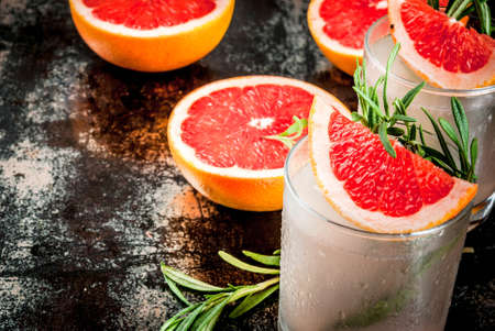 Alcohol drink, Rosemary, Grapefruit & Gin Cocktail, On a black rusty metallic background, copy space Stock Photo
