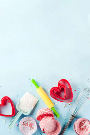 Sweet baking concept for Valentine's day,  cooking background with baking - with a rolling pin, whisk for whipping, cookie cutters, sugar sprinkling, flour. Light blue background, top view copy space 版權商用圖片 - 91840773