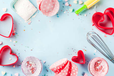 Sweet baking concept for Valentine's day,  cooking background with baking - with a rolling pin, whisk for whipping, cookie cutters, sugar sprinkling, flour. Light blue background, top view copy space Stock Photo - 91840774