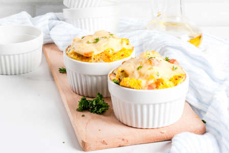 Homemade italian bread casserole strata with cheese, egg and ham, white background copy space