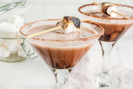 New Year and Christmas drinks idea, Toasted smores martini, white background, copy space