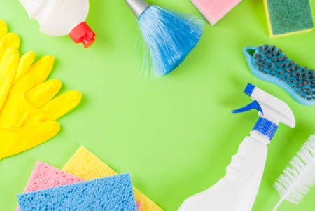Spring cleaning concept with supplies, house cleaning products pile. Stock Photo