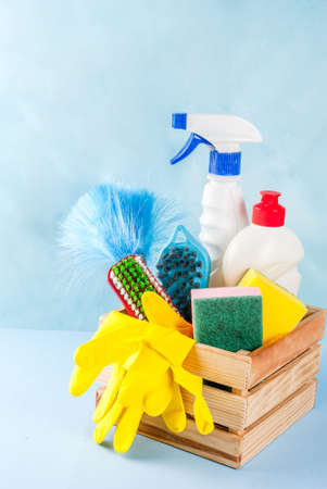 Spring cleaning concept with supplies, house cleaning products pile. Household chore concept, on light blue background copy space Standard-Bild