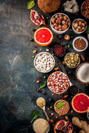 Set of organic healthy diet food, superfoods - beans, legumes, nuts, seeds, greens, fruit and vegetables. Dark blue background copy space top view Stok Fotoğraf - 94279872