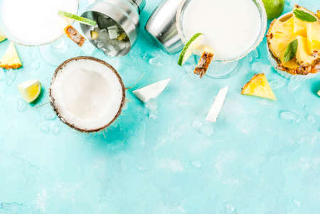 Tropical drink, Frozen Coconut Pineapple Margaritas with frozen pina colada, tequila, pineapple juice and lime,  light blue background, copy space top view