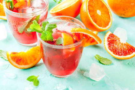Summer cold drink, blood orange mint cocktail - mimosa, mojito or sangria,  light blue background, copy space Stok Fotoğraf - 94926668