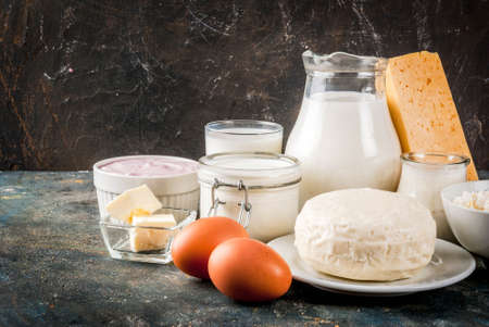 Healthy food concept. Set of dairy products dark blue background copy space Banque d'images
