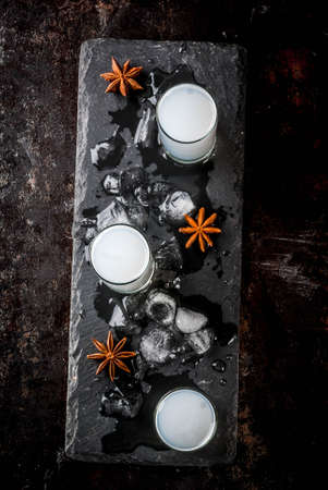 Traditional arabic alcohol drink Raki with anise, dark rusty background copy space top view