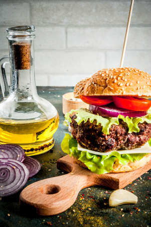 Fast food. Unhealthy food. Delicious Fresh Tasty Burger with Beef Cutlet, fresh Vegetables and Cheese on dark blue concrete background. Copy space