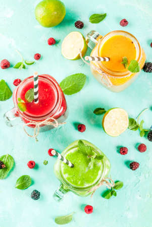 Healthy fresh fruit and veggie smoothies with ingredients on light blue concrete table, copy space top view Banque d'images