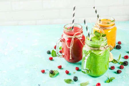 Healthy fresh fruit and veggie smoothies with ingredients on light blue concrete table, copy space Stok Fotoğraf - 95357437