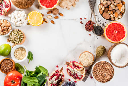 Set of organic healthy diet food, superfoods - beans, legumes, nuts, seeds, greens, fruit and vegetables.. white background copy space. top view frame Stok Fotoğraf