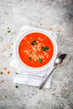 Tomato soup, Gazpacho in white bowl on grey stone background, with ingredients  Copy space top view Stok Fotoğraf