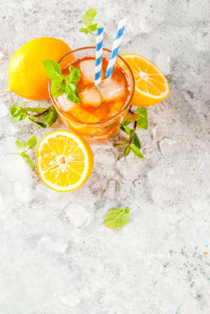Cold summer drink. iced tea with lemon and mint, on grey stone background.  Copy space top view Stok Fotoğraf