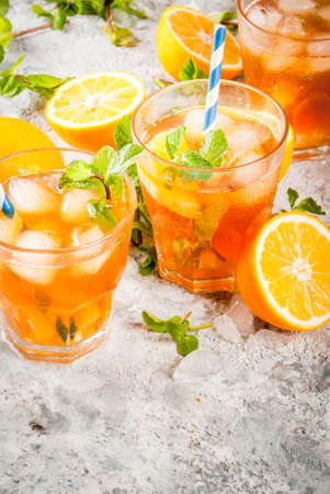 Cold summer drink. iced tea with lemon and mint, on grey stone background.  Copy space Stok Fotoğraf