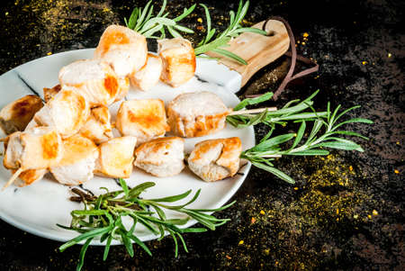 Grill, barbecue meat. Chicken skewers with rosemary. On a black rusty metallic background, copy space Stock Photo - 96378363