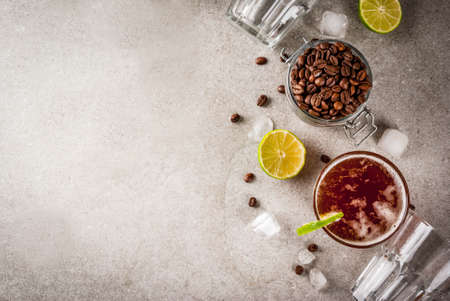Espresso Tonic, refreshment summer drink with tonic water, lime and coffee, grey stone table, copy space top view