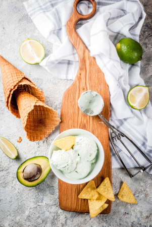 Mexican food, homemade organic lime and avocado ice cream, with ice cream cones, slices of sweet tortilla. On a grey stone table, copy space Reklamní fotografie