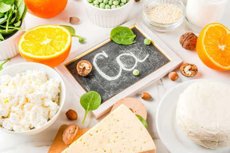 Healthy food concept. Set of food rich in calcium - dairy and vegan Ca products, white marble background Stok Fotoğraf