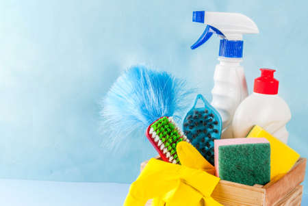 Spring cleaning concept with supplies, house cleaning products pile. Household chore concept, on light blue background copy space Stockfoto