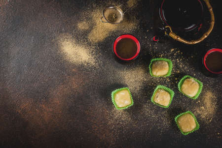 Matcha tea  with green mochi, dark rusty background. Copy space top view