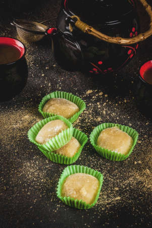 Matcha tea  with green mochi, dark rusty background. Copy space Stok Fotoğraf
