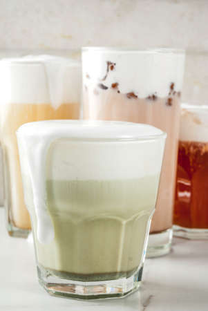 Trendy food and drinks, assortment 4 kinds of Cheese Tea with whipped cream cheese, on white background