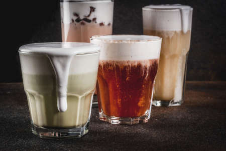 Trendy food and drinks, assortment 4 kinds of Cheese Tea with whipped cream cheese, on dark background Stok Fotoğraf - 97835640
