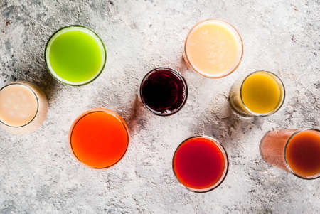 Healthy Food Concept,  Different Fruit and Vegetables Juices Smoothie  in Glasses top view copy space Stock Photo