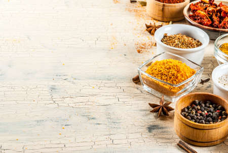 Set of various spices on light concrete background. Copy space.