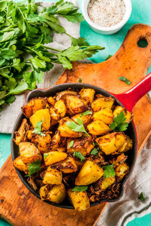 Indian food, Bombay Potatoes on light blue background copy space top view Stock Photo