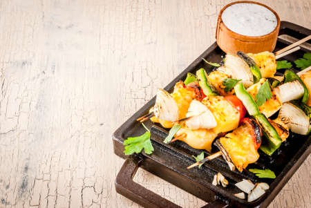 Vegan diet food, Grilled cheese and vegetables kebab, indian style Paneer Tikka, with white sauce and lime, on light concrete background, copy space Stock Photo