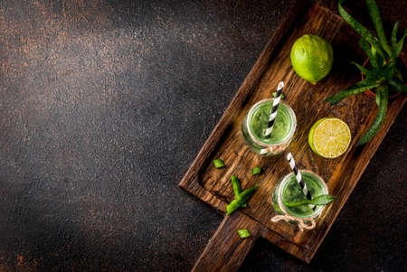 Healthy exotic detox drink, aloe vera or cactus juice with lime, on dark background copy space