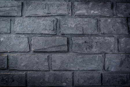 Old dark grey brick wall, background, horizontal Stok Fotoğraf