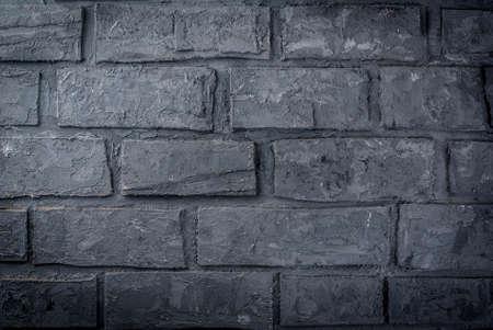 Old dark grey brick wall, background, horizontal Stock Photo
