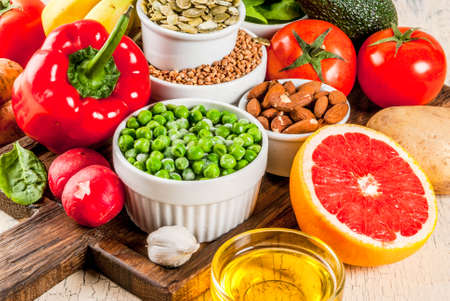 Healthy food background, trendy Alkaline diet products - fruits, vegetables, cereals, nuts. oils, light concrete background close view Stockfoto