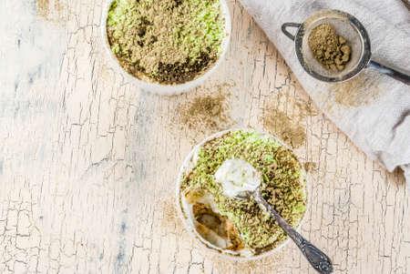 Trendy asian dessert, Green matcha tiramisu, light concrete backgound