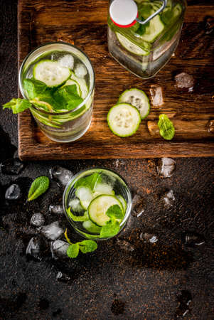 Summer fresh iced drink, mint and cucumber infused water, summer healthy detox mojito cocktail, light background copy space 写真素材