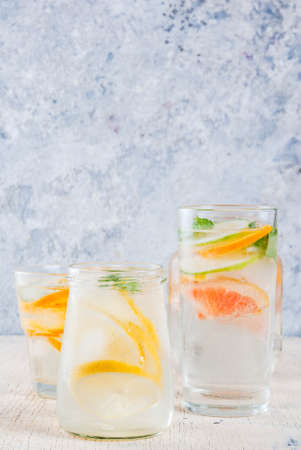 Summer healthy cocktails, set of various citrus infused waters, lemonades or mojitos, with lime lemon orange grapefruit, diet detox beverages, in different glasses light background copy space Stock Photo