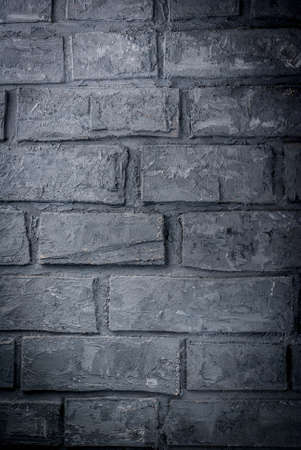 Old dark grey brick wall, background, vertical Stok Fotoğraf
